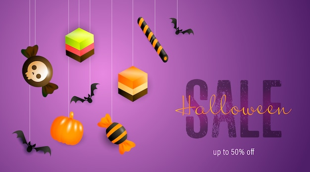 Bannière de vente halloween avec des bonbons et des bonbons