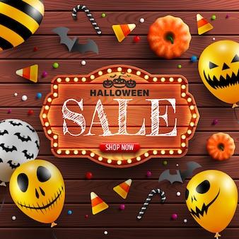 Bannière de vente halloween avec planche de bois vintage