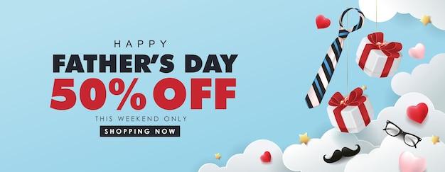 Bannière de vente heureuse fête des pères avec boîte-cadeau et forme de coeur