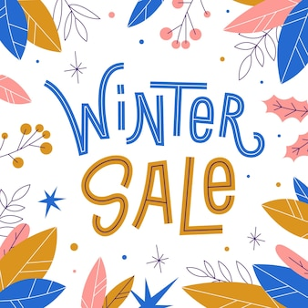 Bannière de vente d'hiver avec des flocons de neige et des feuilles.