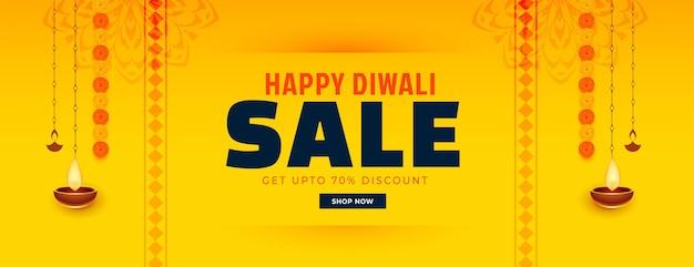 Bannière de vente jaune joyeux diwali avec fleur et diya