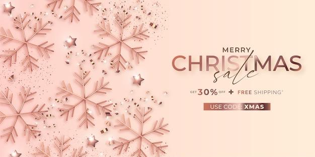 Bannière de vente de noël élégante avec des flocons de neige roses dorés