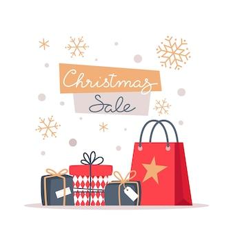 Bannière de vente de noël avec des flocons de neige et des cadeaux