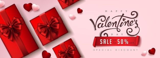 Bannière de vente de la saint-valentin avec boîte-cadeau et coeur.