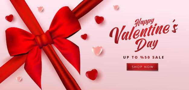 Bannière de vente de la saint-valentin avec de nombreux coeurs doux et un arc réaliste.