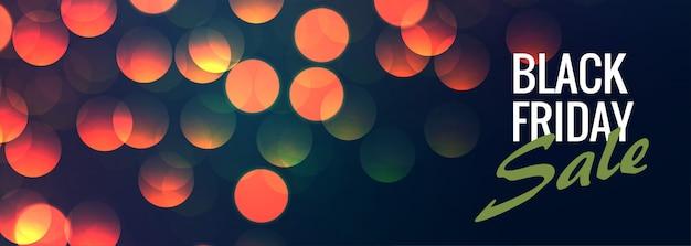 Bannière de vente vendredi noir avec des lumières de bokeh