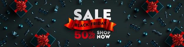 Bannière de vente vendredi noir pour la vente au détail, le shopping ou la promotion avec ruban rouge, boîte-cadeau noire et élément de noël sur fond sombre conception de bannière vendredi noir.