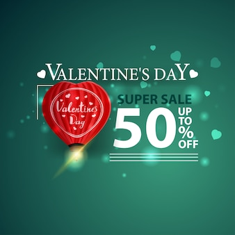 Bannière verte à prix réduit pour la saint-valentin avec ballon en forme de cœur