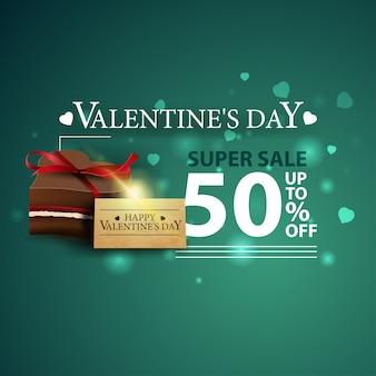 Bannière verte à prix réduit pour la saint-valentin avec des bonbons au chocolat