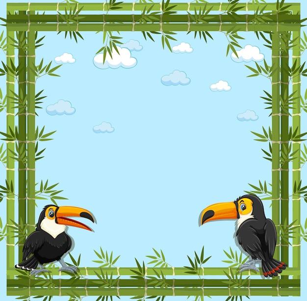 Bannière vide avec cadre en bambou et personnage de dessin animé toucan