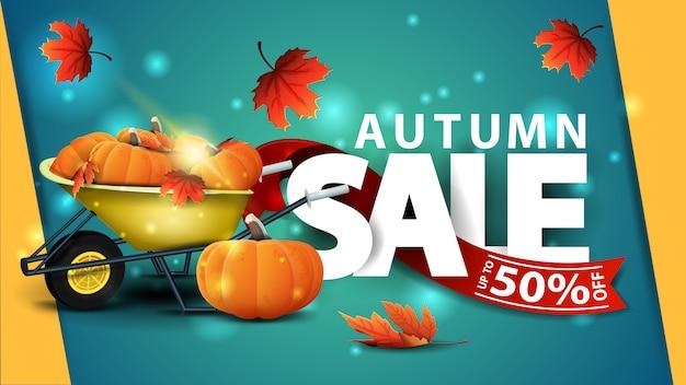 Bannière web vert vente automne avec brouette de jardin avec une récolte de citrouilles