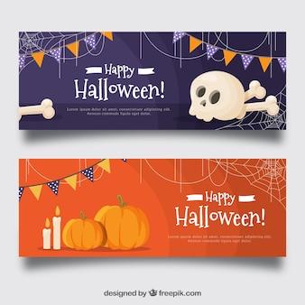 Bannières de célébration de halloween avec des os et des citrouilles