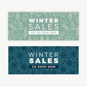 Bannières dessinées à la main de vente d'hiver