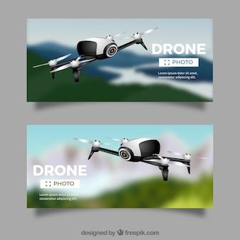 Bannières avec drones dans le ciel