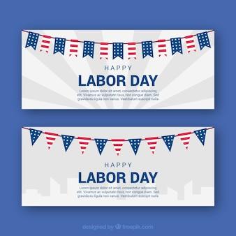 Bannières du jour du travail avec des drapeaux