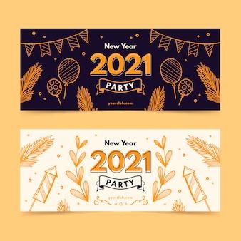 Bannières de fête du nouvel an 2021 dessinées à la main