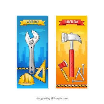 Bannières de la fête du travail avec des outils