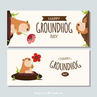Bannières groundhog avec des fleurs
