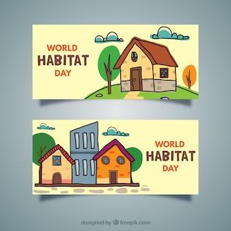 Bannières de la journée mondiale de l'habitat avec des maisons dessinés à la main