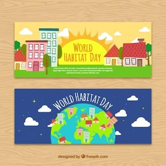 Bannières de la journée mondiale de l'habitat avec des villes