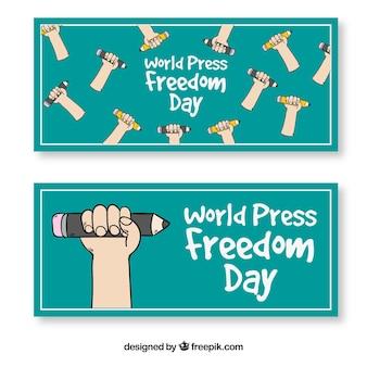 Bannières de la journée mondiale de la liberté de la presse avec des mains et des crayons dessinés à la main