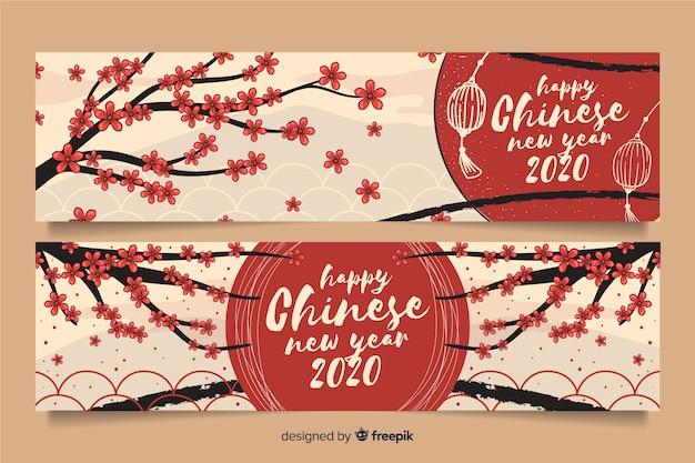 Bannières de joyeux nouvel an chinois dessinés à la main