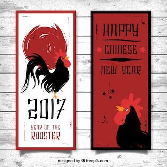 Bannières rouges et noires pour l'année du coq