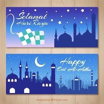 Bannières avec la silhouette d'une mosquée dans la nuit
