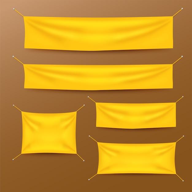 Bannières textiles jaunes avec ensemble de modèles de plis