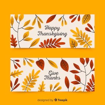 Bannières de thanksgiving dessinées à la main avec des feuilles séchées