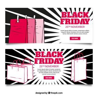 Bannières vendredi noir avec des sacs de shopping et de fond sunburst
