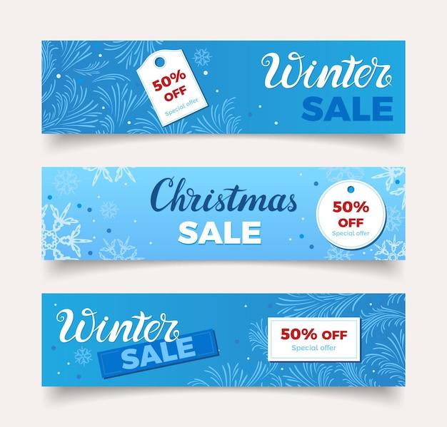 Bannières de vente de noël d'hiver sur fond bleu avec des motifs givrés et des flocons de neige