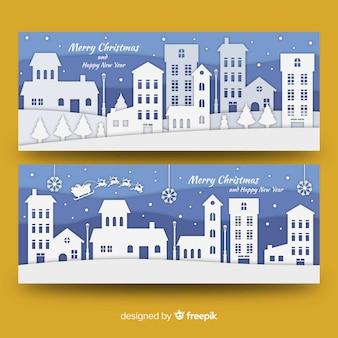Bannières de ville de noël dans le style de papier