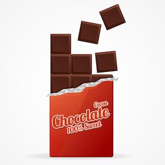 Barre de chocolat noir ouverte dans du papier d'emballage rouge