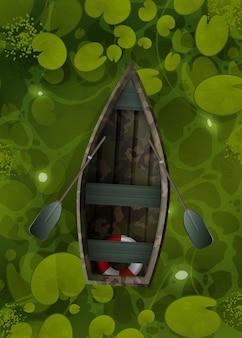 Bateau de camouflage flotte à travers le marais avec des feuilles de nénuphar