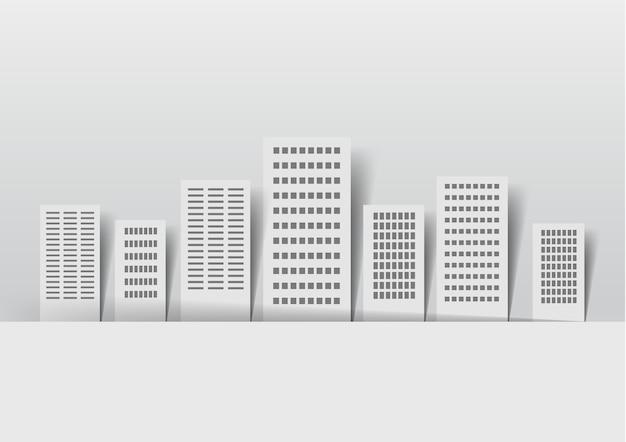 Bâtiments en papier sur fond clair: autocollants, ville, fenêtres