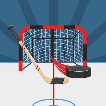 Bâtons de hockey avec rondelle et but dans la patinoire