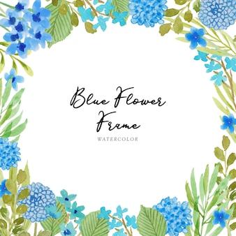 Un beau cadre aquarelle de fleurs bleues peint à la main