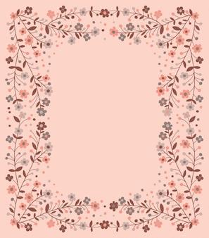 Beau cadre de branches en fleurs sur fond rose