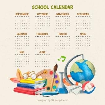 Beau calendrier avec des fournitures scolaires en aquarelle