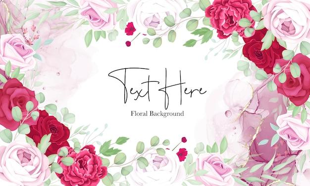 Beau fond de cadre floral rouge et rose avec une élégante encre à l'alcool