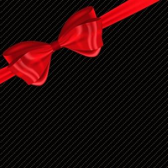 Beau fond avec noeud et ruban rouge en soiepeut être utilisé pour la couverture de boîte-cadeau