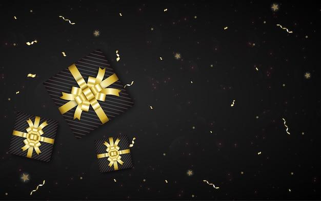 Beau fond noir avec ruban de couleur dorée, boîte-cadeau et espace de copie