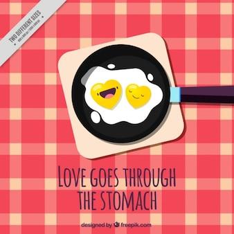 Beau fond d'œufs frits dans une casserole avec la phrase d'amour