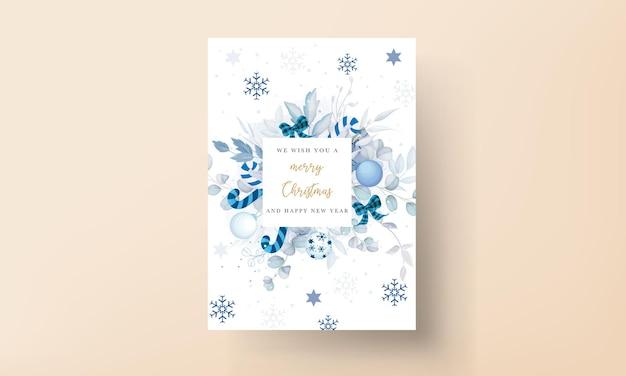 Beau modèle de carte de noël avec des ornements de noël blancs et bleus
