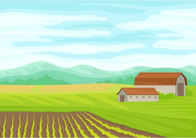 Beau paysage avec une grange en pierre au centre.