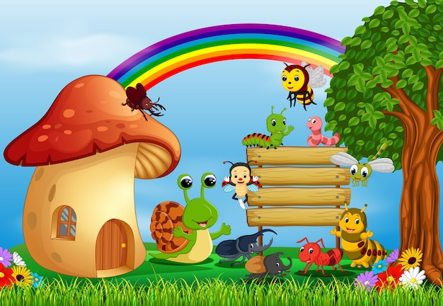 Beaucoup d'insectes et une maison de champignons dans la forêt