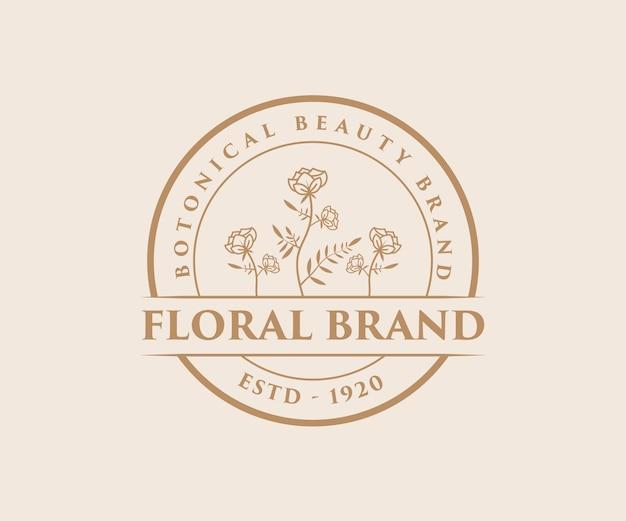 Beauté féminine dessinée à la main et logo botanique floral pour salon de spa de soins de la peau