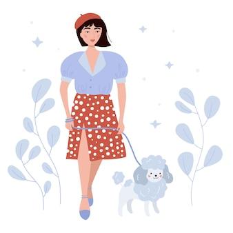 Beauté femme française avec chien caniche