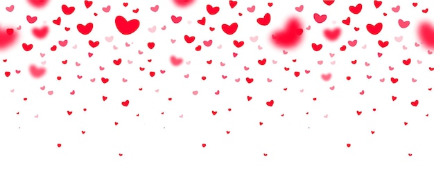 Beaux coeurs tombants rouges au point et en défocalisation sur fond blanc